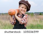 Smiling Boy Standing With...