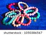 eight multi colored bracelets... | Shutterstock . vector #1050386567