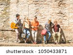 group of happy excited friends... | Shutterstock . vector #1050433871