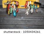 assorted work tools on wooden... | Shutterstock . vector #1050434261
