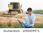 young farmer engineer with... | Shutterstock . vector #1050459971