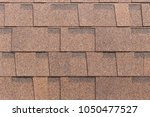 brown shingle roof tiles... | Shutterstock . vector #1050477527