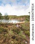 uath lochan at glen feshie in...   Shutterstock . vector #1050478514