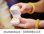 bride's hand hold white box to... | Shutterstock . vector #1050481115
