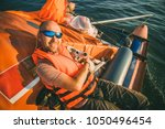 dog and owner on yacht bord on...   Shutterstock . vector #1050496454