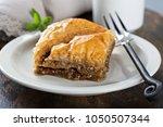 baklava on a dessert plate with ... | Shutterstock . vector #1050507344