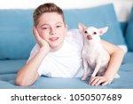 smiling teenage boy 13 14 year... | Shutterstock . vector #1050507689