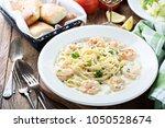 creamy fettuccine alfredo with... | Shutterstock . vector #1050528674