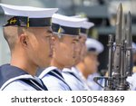 Small photo of CHONBURI, THAILAND - MARCH 15, 2018 : Royal Thai Navy petty officers in summer white uniform hold M16 rifles with bayonets on board ship on March 15, 2018 in Lamthien Naval Base, Chonburi, Thailand.