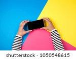 woman's hands with smartphone... | Shutterstock . vector #1050548615