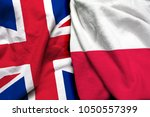 england and poland flag together | Shutterstock . vector #1050557399