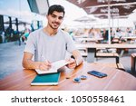 portrait of cheerful young man... | Shutterstock . vector #1050558461