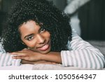 close up of a pretty black... | Shutterstock . vector #1050564347