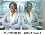 smiling businesswoman with... | Shutterstock . vector #1050576275