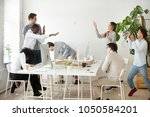 happy multiracial business... | Shutterstock . vector #1050584201