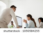 angry boss scolding criticizing ... | Shutterstock . vector #1050584255
