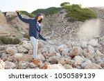 teenager male balancing... | Shutterstock . vector #1050589139
