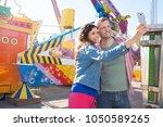 beautiful tourist couple...   Shutterstock . vector #1050589265