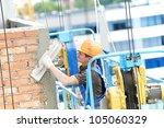 builder worker plastering... | Shutterstock . vector #105060329