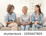 happy female friends chatting... | Shutterstock . vector #1050607805