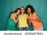 happy female friends having fun ... | Shutterstock . vector #1050607841