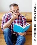 portrait of handsome bearded... | Shutterstock . vector #1050610277