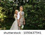 bride and groom embracing in...   Shutterstock . vector #1050637541