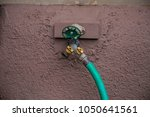 hose valve close up green dial... | Shutterstock . vector #1050641561