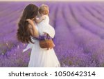 happy mother with pretty... | Shutterstock . vector #1050642314