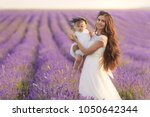 happy mother with pretty... | Shutterstock . vector #1050642344