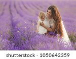 happy mother with pretty... | Shutterstock . vector #1050642359