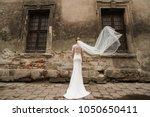 the bride is standing next to...   Shutterstock . vector #1050650411