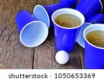 blue plastic beer cups