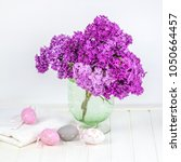 lilac in the vase  with easter ... | Shutterstock . vector #1050664457