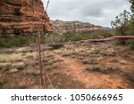 barbed wire rusted wooden fence ... | Shutterstock . vector #1050666965