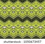 ikat geometric folklore... | Shutterstock .eps vector #1050673457