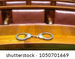 handcuffs on the indictment...   Shutterstock . vector #1050701669