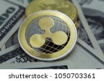 ripple coin and banknotes... | Shutterstock . vector #1050703361