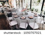 wedding banquet table which is... | Shutterstock . vector #1050707021