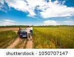 two bird watchers  tweechers in ... | Shutterstock . vector #1050707147