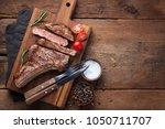 grilled cowboy beef steak ... | Shutterstock . vector #1050711707