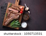 grilled cowboy beef steak ... | Shutterstock . vector #1050713531
