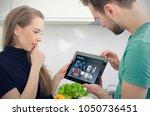 couple using digital tablet for ... | Shutterstock . vector #1050736451