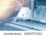 Small photo of The CNC milling machine cutting the tire mold by index-able ball end-mill tool.