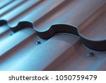 butt of the shingles. metal... | Shutterstock . vector #1050759479