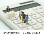 miniature people pay queue... | Shutterstock . vector #1050779315