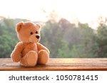 teddy bear toy alone on wood | Shutterstock . vector #1050781415