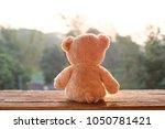 teddy bear toy alone on wood | Shutterstock . vector #1050781421