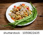 papaya salad. traditional spicy ... | Shutterstock . vector #1050822635