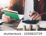 accountant calculating the... | Shutterstock . vector #1050823739
